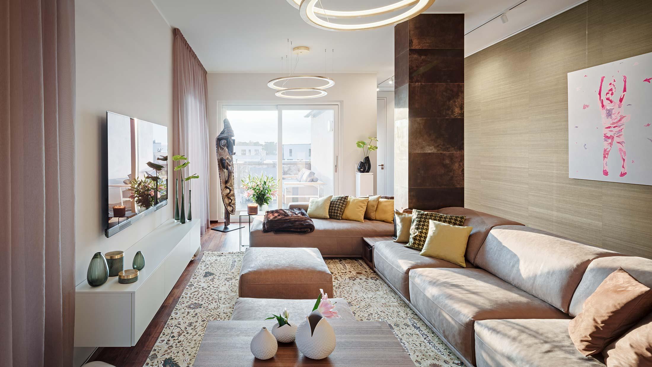 Penthouse Fünf Morgen: Wohnzimmer mit großzügiger Ledercouch